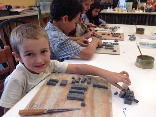 Boy building Mine Craft reptile at The Ceramics Studio